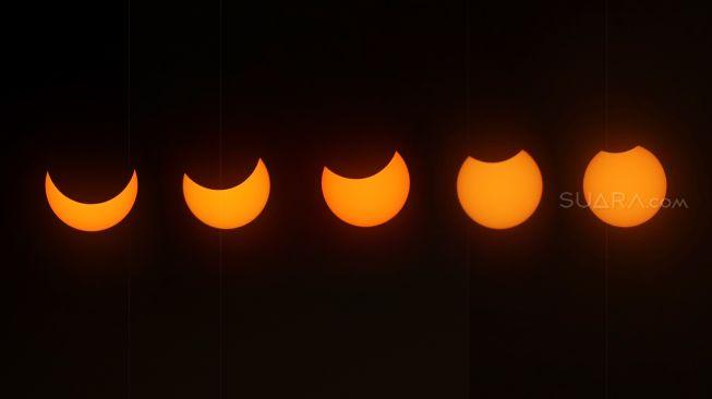 Gerhana matahari cincin terpantau dari Planetarium Daman Ismail Marzuki di Jakarta, Kamis (26/12). [Suara.com/Angga Budhiyanto]